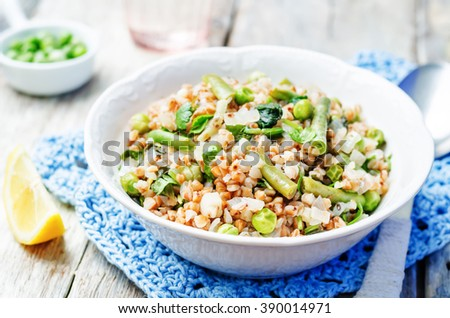 Buckwheat with green peas and beans on white wood background. toning. selective focus - stock photo
