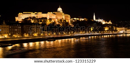 Buda Castle and Fisherman's Bastion by Danube river at night. Budapest, Hungary - stock photo