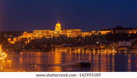 Buda Castle (Royal Palace) by the Danube river illuminated at night in Budapest, Hungary - stock photo
