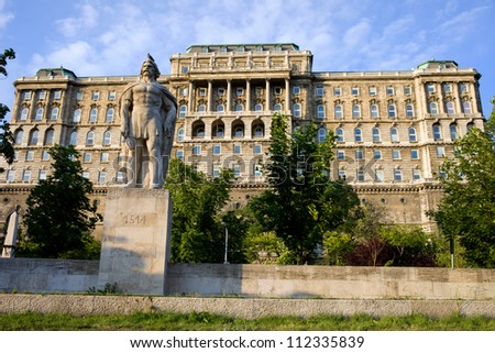 Buda Castle (Royal Palace) rear view, 18th century Baroque style facade and the Dozsa Statue in Budapest, Hungary. - stock photo