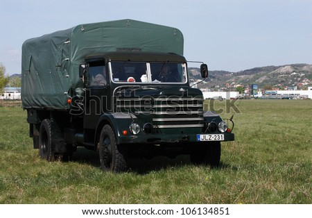 BUDAORS, HUNGARY - APRIL 22: an unidentified man drives a Soviet truck named Csepel D-352 on display at the (G)Old-timer Day show on April 22, 2012 in Budaors, Hungary