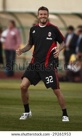BUDAPEST - APRIL 22: David Beckham of AC Milan smiles during friendly football game (Hungarian League Team vs AC Milan) April 22, 2009 in Budapest, Hungary.
