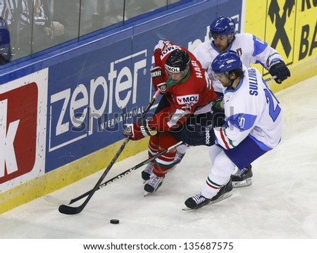 BUDAPEST - APRIL 19: Hungarian Hari (L), Italian Sullivan (R) and Fontanive during Hungary vs Italy World Championship ice hockey match at Budapest Sportarena on April 19, 2013 in Budapest, Hungary - stock photo