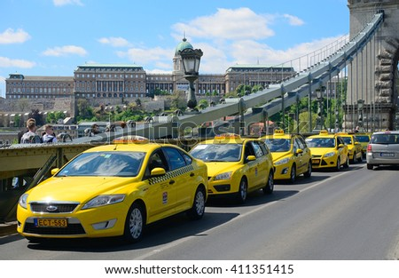 BUDAPEST - APRIL 26 :Taxis block the Chain Bridge at 26 April, 2016 in Budapest, Hungary. Taxi drivers protest against illegal passenger transport companies, feraing their daily work and life.  - stock photo