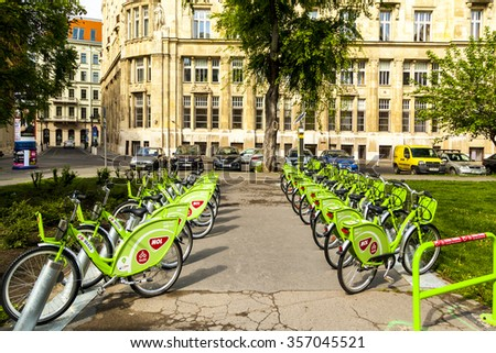 BUDAPEST APRL 29 2014:Bike rental service BUBI (Budapest bicycle sharing system) bikes at a docking station in front of the central market hall in Budapest, Hungary. - stock photo
