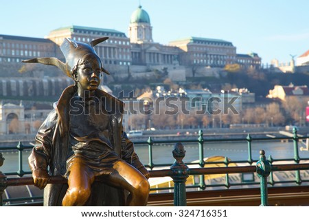 Budapest Attractions. Little Princess perched by the tram rails on the Pest, with Buda Castle in background, landmark of Hungary capital city. Budapest, Hungary.  - stock photo