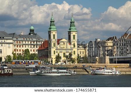 Budapest - Belvarosi plebania templom (Inner City Parish Church) on the Danube River embankment. Danube River embankment in Budapest is World Heritage Site by UNESCO - stock photo