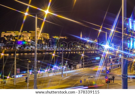 Budapest Castle, danube river and  Budapest streets at night. Hungary. Cross Filter Effect