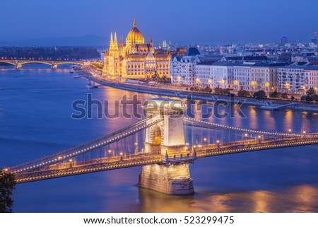 Budapest city night scene. View at  Chain bridge, river Danube and famous building of Parliament. Budapest city is capital of east european country Hungary.