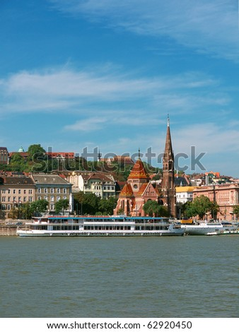 Budapest, Danube river with boats and historic buildings - stock photo