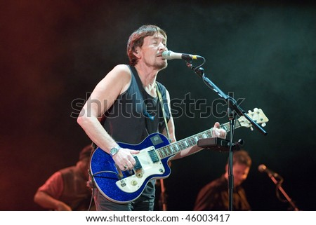 BUDAPEST - FEBRUARY 04: Chris Rea performs on stage at Sportarena on February 04, 2010 in Budapest, Hungary. - stock photo