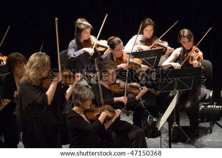 BUDAPEST - FEBRUARY 16: Members of the Pest Country Symphonic Orchestra perform at Urania Hall on February 16, 2010 in Budapest, Hungary. - stock photo