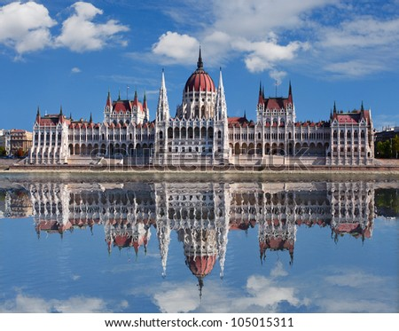 Budapest - Hungarian parliament.with reflection in Danube river - stock photo