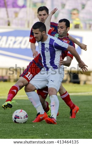 BUDAPEST, HUNGARY - APRIL 30, 2016: Bojan Sankovic of Ujpest (m) fights for the ball with Filipe Oliveira (16) of Videoton during Ujpest - Videoton OTP Bank League football match at Szusza Stadium.