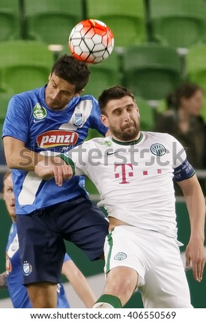 BUDAPEST, HUNGARY - APRIL 16, 2016: Daniel Bode of Ferencvaros (r) duels for the ball with Mato Grgic of MTK during Ferencvaros - MTK Budapest OTP Bank League football match at Groupama Arena.  - stock photo