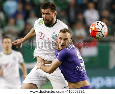BUDAPEST, HUNGARY - APRIL 23, 2016: Daniel Bode of FTC (l) battles for the ball in the air with Robert Litauszki of Ujpest during Ferencvaros - Ujpest OTP Bank League football match at Groupama Arena. - stock photo