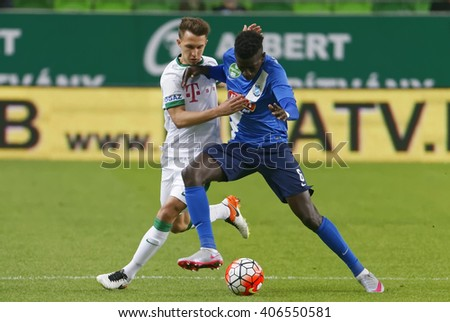 BUDAPEST, HUNGARY - APRIL 16, 2016: Dominik Nagy of Ferencvaros (l) fights for the ball with Thiam Khaly Iyane of MTK during Ferencvaros - MTK Budapest OTP Bank League football match at Groupama Arena - stock photo