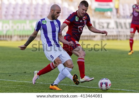 BUDAPEST, HUNGARY - APRIL 30, 2016: Jonathan Heris of Ujpest (l) duels for the ball with Krisztian Geresi of Videoton during Ujpest - Videoton OTP Bank League football match at Szusza Stadium.