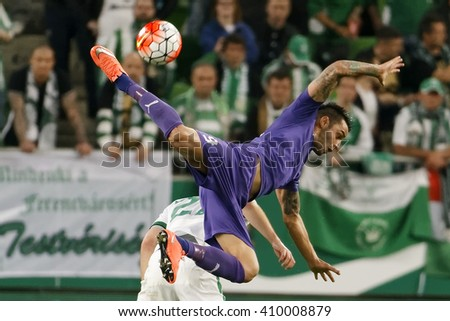 BUDAPEST, HUNGARY - APRIL 23, 2016: Laszlo Lencse of Ujpest flies in the air during Ferencvaros - Ujpest OTP Bank League football match at Groupama Arena. - stock photo