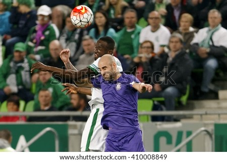 BUDAPEST, HUNGARY - APRIL 23, 2016: Roland Lamah of FTC (l) battles for the ball in the air with Jonathan Heris of Ujpest during Ferencvaros - Ujpest OTP Bank League football match at Groupama Arena.  - stock photo