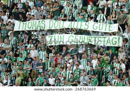 BUDAPEST, HUNGARY - APRIL 12, 2015: The fans of Ferencvaros wish happy birthday to the head coach, Thomas Doll during Ferencvaros vs. Ujpest OTP Bank League football match in Groupama Arena.