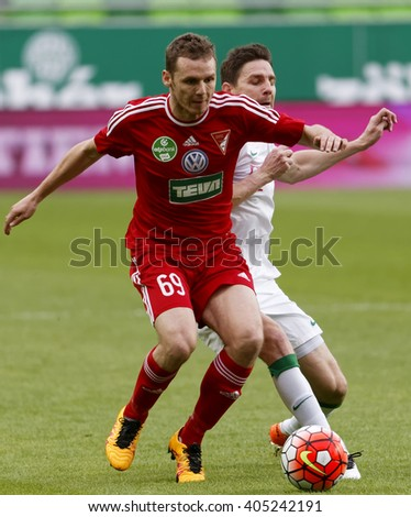 BUDAPEST, HUNGARY - APRIL 13, 2016: Zoltan Gera of Ferencvaros (r) battles for the ball with Mihaly Korhut of DVSC during Ferencvaros - DVSC Hungarian Cup semi-final football match at Groupama Arena. - stock photo