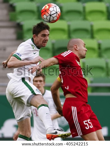 BUDAPEST, HUNGARY - APRIL 13, 2016: Zoltan Gera of FTC (l) battles for the ball in the air with Peter Szakaly of DVSC during FTC - DVSC Hungarian Cup semi-final football match at Groupama Arena.  - stock photo