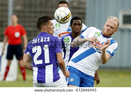 BUDAPEST, HUNGARY - AUGUST 21, 2016: Benjamin Balazs #21 of Ujpest FC competes for the ball with Patrik Poor (R) of MTK during the OTP Bank Liga match between Ujpest and MTK at Illovszky Stadium.