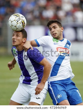 BUDAPEST, HUNGARY - AUGUST 21, 2016: Enis Bardhi (L) of Ujpest FC competes for the ball with Balint Borbely (R) of MTK during the OTP Bank Liga match between Ujpest FC and MTK at Illovszky Stadium.