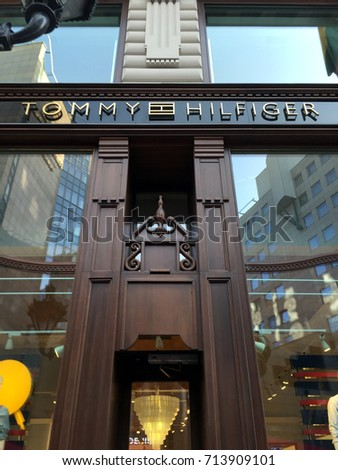 BUDAPEST, HUNGARY - AUGUST 3, 2017:  Facade of a Tommy Hilfiger shop in Budapest, Hungary. This  American multinational corporation designs and manufactures upper market apparel for men and women.