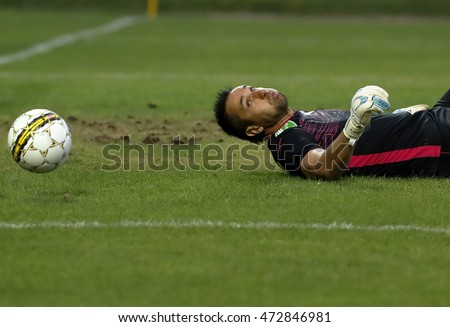 BUDAPEST, HUNGARY - AUGUST 21, 2016: Goalkeeper Szabolcs Balajcza of Ujpest FC watches a shot go wide during the Hungarian OTP Bank Liga match between Ujpest FC and MTK Budapest at Illovszky Stadium.