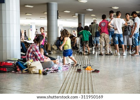 BUDAPEST, HUNGARY - AUGUST 31: Refugees and immigrants stranded at the eastern Train Station on August 31, 2015 in Budapest, Hungary.   - stock photo