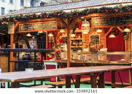 BUDAPEST, HUNGARY - DEC 19 2015: Tourists enjoy the Christmas market in the city center on in Budapest, Hungary. This traditional Christmas fair attracts 700,000 visitors each year. - stock photo