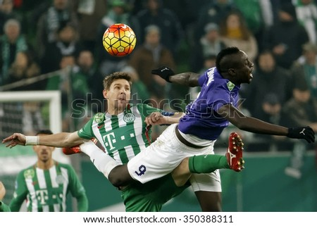 BUDAPEST, HUNGARY - DECEMBER 12, 2015: Air battle between Zoltan Gera of Ferencvaros (l) and Mbaye Diagne of Ujpest during Ferencvaros - Ujpest OTP Bank League football match at Groupama Arena.  - stock photo