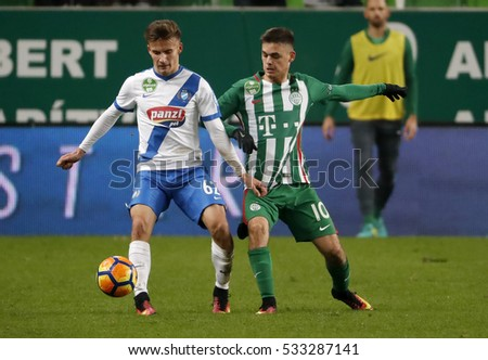 BUDAPEST, HUNGARY - DECEMBER 10, 2016: Andras Rado #10 of Ferencvarosi TC competes for the ball with Roland Takacs #62 of MTK Budapest during Ferencvaros v MTK OTP Bank Liga match at Groupama Arena