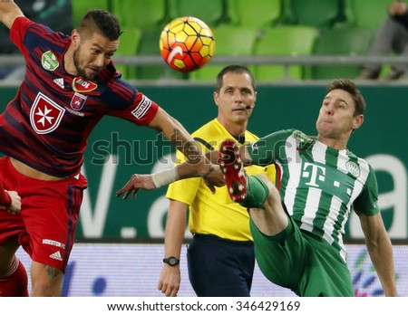 BUDAPEST, HUNGARY - DECEMBER 2, 2015: Peter Solymosi watches Zoltan Gera of FTC (r) and Robert Feczesin  (l) of Videoton during Ferencvaros - Videoton OTP Bank League football match at Groupama Arena. - stock photo