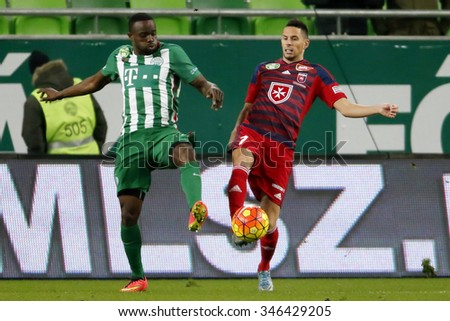 BUDAPEST, HUNGARY - DECEMBER 2, 2015: Roland Lamah of Ferencvaros (l) tries to get the ball from Adam Gyurcso of Videoton during Ferencvaros - Videoton OTP Bank League football match at Groupama Arena - stock photo