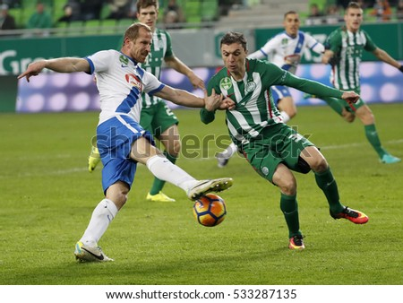 BUDAPEST, HUNGARY - DECEMBER 10, 2016: Vladan Cukic (R) of Ferencvarosi TC tries to block the shot from Sandor Torghelle (L) of MTK during Ferencvaros v MTK OTP Bank Liga match at Groupama Arena