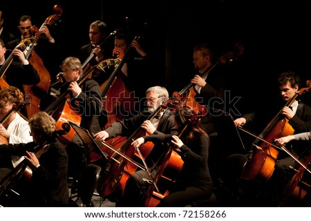 BUDAPEST, HUNGARY - FEB 26: Members of the Szegedi Symphonic Orchestra performs at The Thalia Theatre stage on February 26, 2011 in Budapest, Hungary. - stock photo