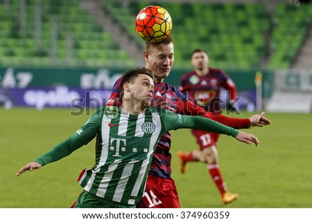 BUDAPEST, HUNGARY - FEBRUARY 10, 2016: Air battle between Andras Rado of Ferencvaros (l) and Adam Lang of Videoton during Ferencvaros - Videoton Hungarian Cup football match at Groupama Arena. - stock photo
