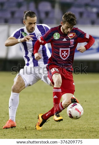 BUDAPEST, HUNGARY - FEBRUARY 13, 2016: David Mohl of Ujpest (l) tries to tackle Asmir Suljic of Videoton during Ujpest - Videoton OTP Bank League football match at Szusza Stadium. - stock photo