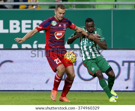 BUDAPEST, HUNGARY - FEBRUARY 10, 2016: Duel between Roland Lamah of Ferencvaros (r) and Roland Juhasz of Videoton during Ferencvaros - Videoton Hungarian Cup football match at Groupama Arena. - stock photo