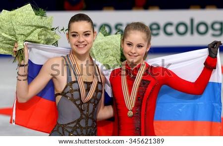 BUDAPEST, HUNGARY - JANUARY 17, 2014: Adelina SOTNIKOVA and Julia LIPNITSKAIA pose at the victory ceremony at ISU European Figure Skating Championship in Syma Hall Arena. - stock photo