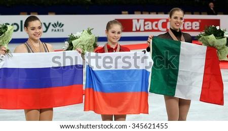BUDAPEST, HUNGARY - JANUARY 17, 2014: Adelina SOTNIKOVA (L), Julia LIPNITSKAIA and Carolina KOSTNER pose at the victory ceremony at ISU European Figure Skating Championship in Syma Hall Arena. - stock photo