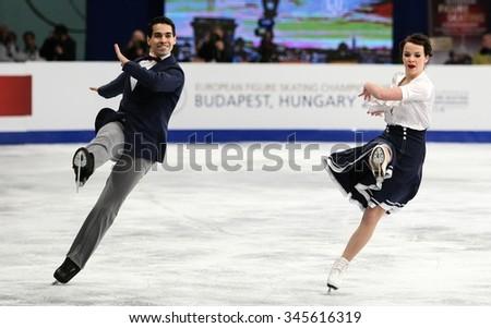 BUDAPEST, HUNGARY - JANUARY 15, 2014: Anna CAPPELLINI / Luca LANOTTE of Italy perform short dance at ISU European Figure Skating Championship in Syma Hall Arena. - stock photo