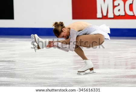 BUDAPEST, HUNGARY - JANUARY 15, 2014: Carolina KOSTNER of Italy performs short program at ISU European Figure Skating Championship in Syma Hall Arena.