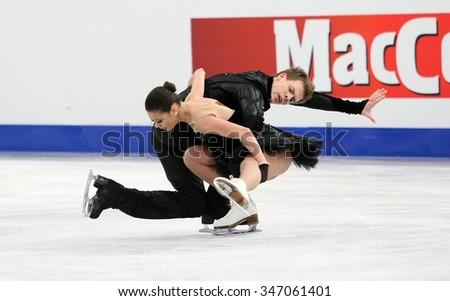BUDAPEST, HUNGARY - JANUARY 16, 2014: Elena ILINYKH / Nikita KATSALAPOV of Russia perform free dance at ISU European Figure Skating Championship in Syma Hall Arena. - stock photo