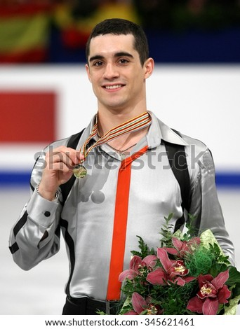 BUDAPEST, HUNGARY - JANUARY 18, 2014: Javier FERNANDEZ of Spain poses at the victory ceremony at ISU European Figure Skating Championship in Syma Hall Arena. - stock photo