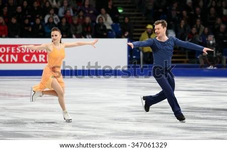 BUDAPEST, HUNGARY - JANUARY 16, 2014: Julia ZLOBINA / Alexei SITNIKOV perform free dance at ISU European Figure Skating Championship in Syma Hall Arena. - stock photo