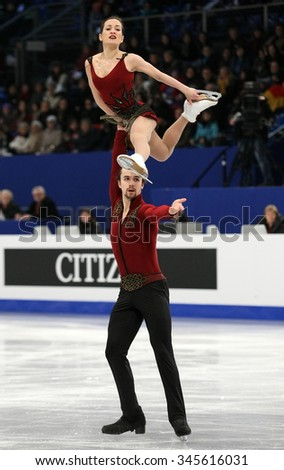 BUDAPEST, HUNGARY - JANUARY 17, 2014: Ksenia STOLBOVA / Fedor KLIMOV of Russia perform short program at ISU European Figure Skating Championship in Syma Hall Arena.